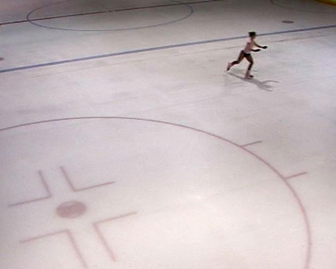 Aerial view of an ice skater on an ice rink