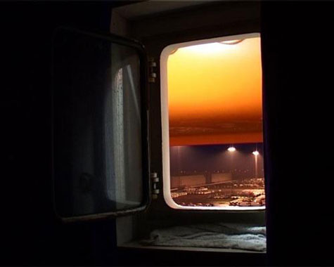 Image of sunset throuh open ship window