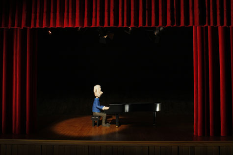 plasticine character on stage playing piano